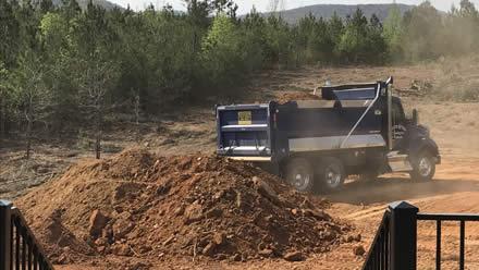 how to start a dump truck hauling service